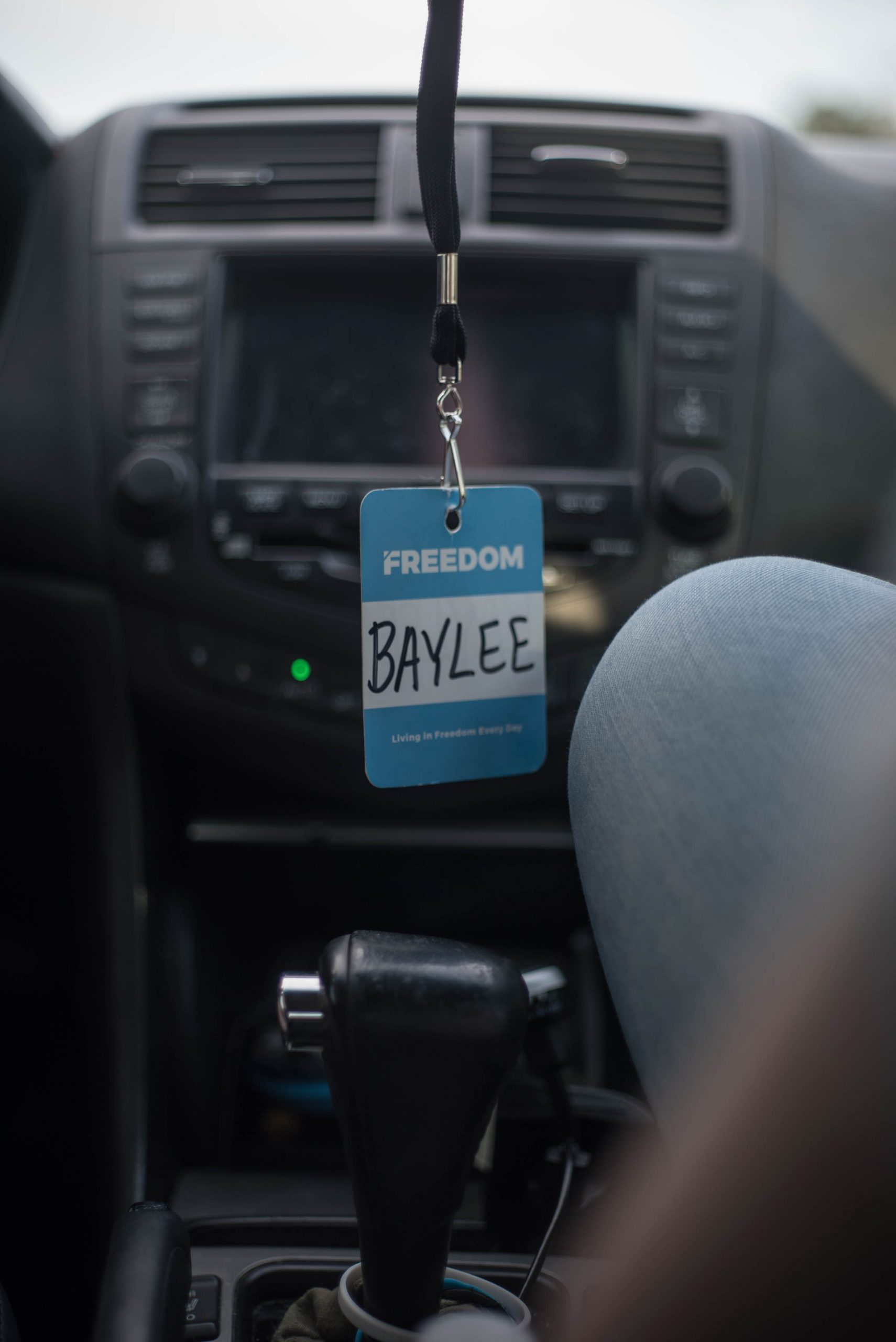 Baylee identification card with blue lanyard